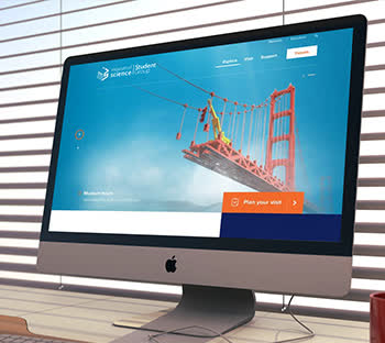 Blue theme. Mac desktop image. Web design & development mockup. Interactive features. Sky & Bridge. Online web solutions.